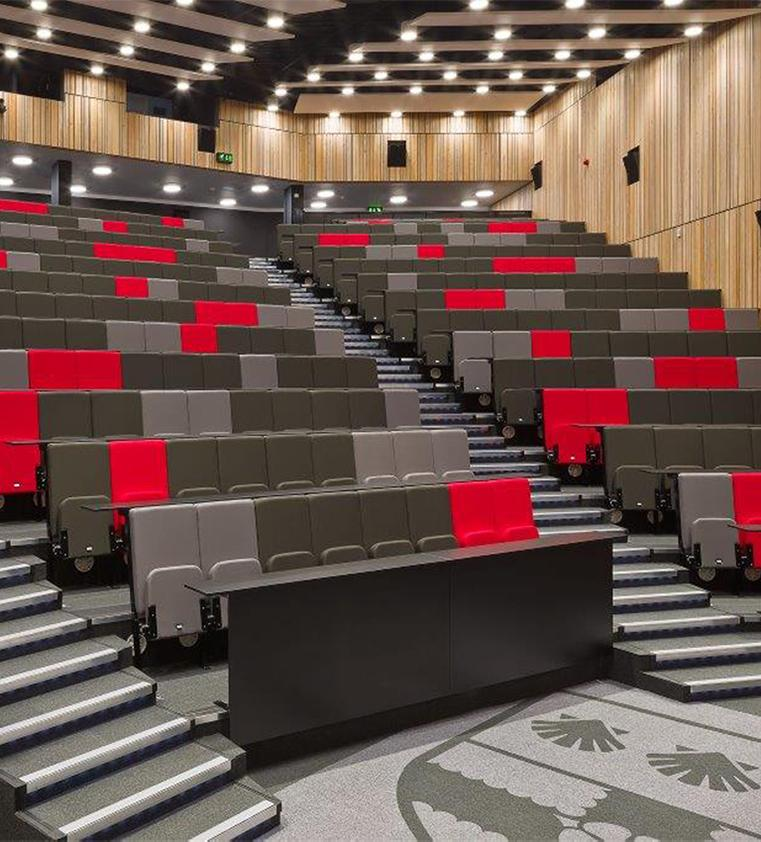 Scholar: Lecture theatre seating with continuous writing tablet